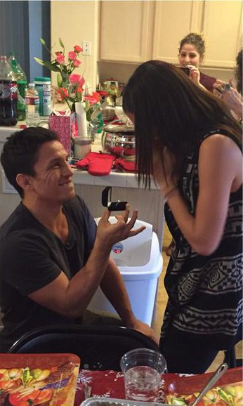 This is the first time we've ever seen somebody propose while standing up.