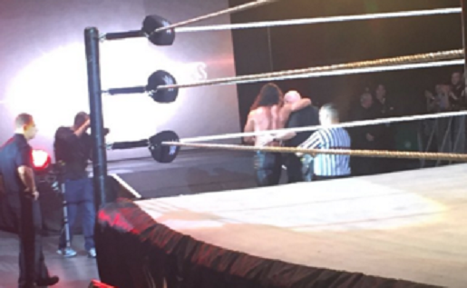 Rollins being helped to the back following the injury. Photo by @joantweetswwe on Twitter.