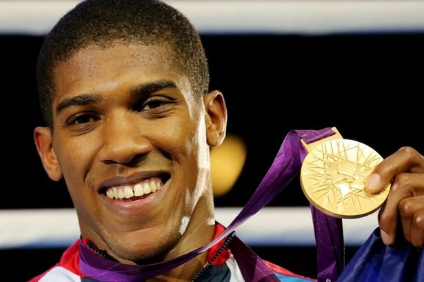 The big man Anthony Joshua with his Gold
