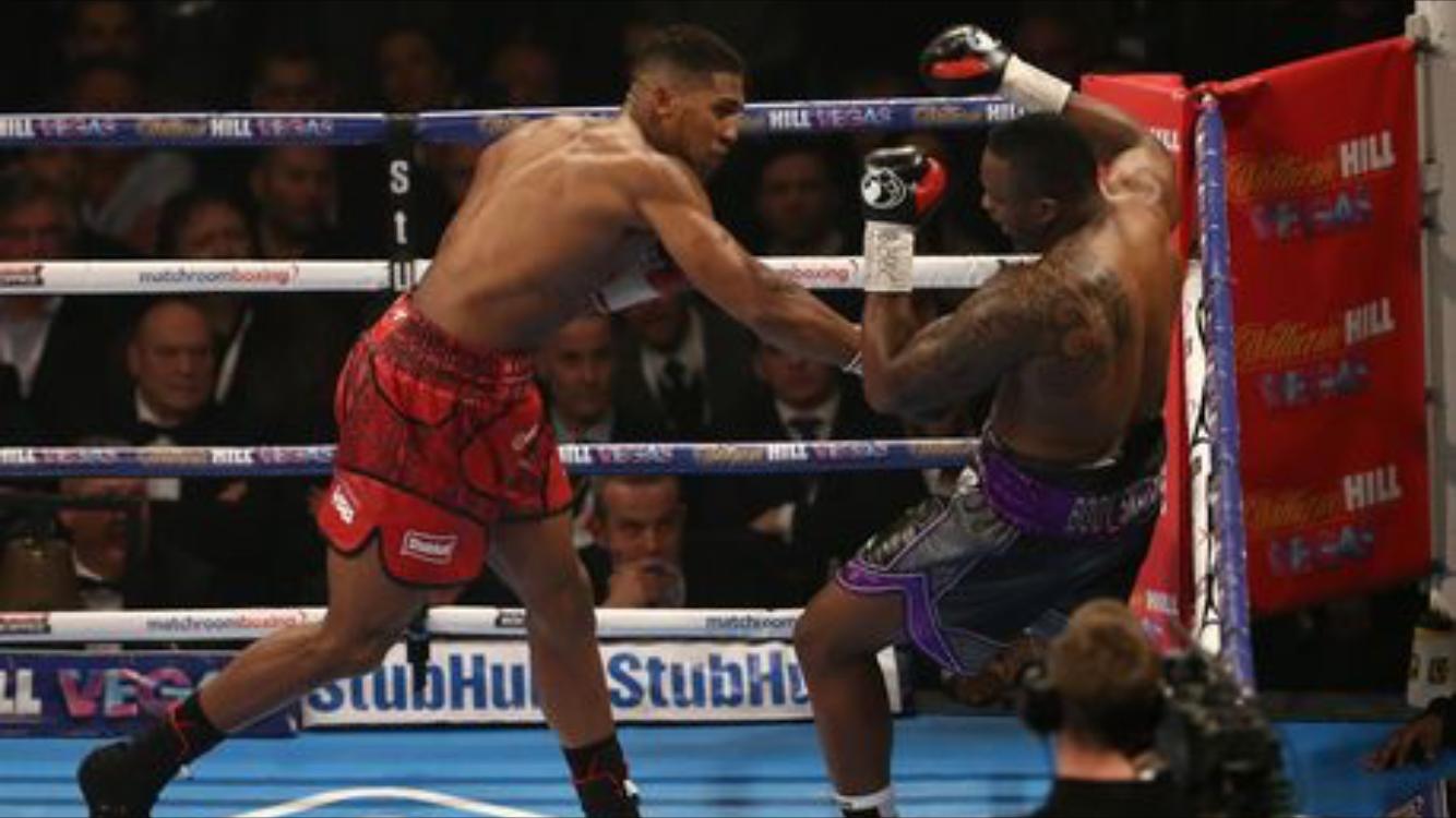 Anthony Joshua defeating Dillian Whyte