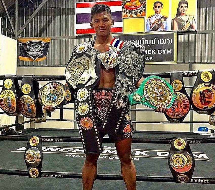 Buakaw Banchamek With his many title belts.
