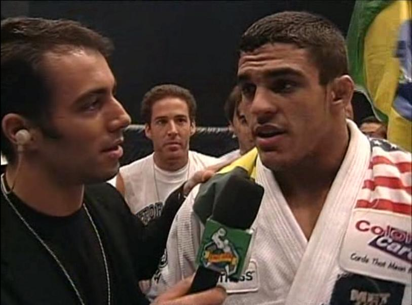 This picture is actually of the UFC debuts of both Joe Rogan and Vitor Belfort.