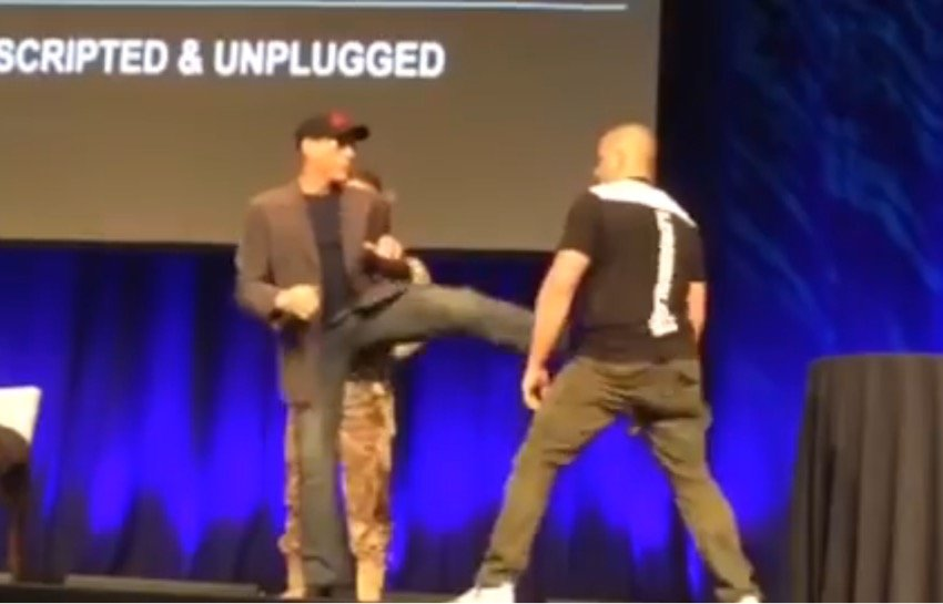Getting his own back, Van Damme gives the super fan a super kick to the nuts.